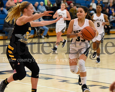 Butler's Aubree Tack #33 drives the lane against North Allegheny's Lizzy Groetsch #32 in Thursday night's game at Butler. Seb Foltz/Butler Eagle