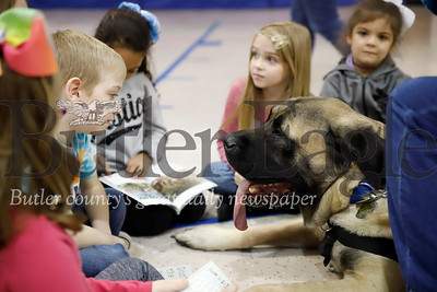 Luke the English Mastiff listens to McQuistion Elementarty students read Friday during the school's read to a dog day with volunteers from the Butler Dog Training Association. Seb Foltz/Butler Eagle