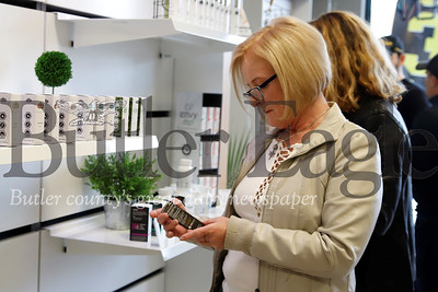 Val Graber browses through CBD products at the grand opening of Hemporia in the Shoppes at Adams Ridge in Mars Saturday. The canibis-based product store, opened by Mars local Dawn Ranalli, is part of a chain of CBD product stores. Seb Foltz/Butler