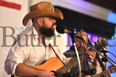Patrick Varine of Sweaty Already sings lead vocals during the band's performance at the annual January Ice Jam bluegrass festival at the Days Inn in Butler. Seb Foltz/Butler Eagle