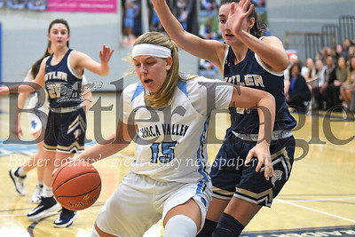 Seneca Valley's Madelyn Karchut (15) fakes inside before sinking a turnaround jump shot over Butler's 21. The Raiders came from behind to beat Butler 59-46 at Seneca. Karchut led the way for the Raiders scoring 20 pts. Seb Foltz/Butler Eagle