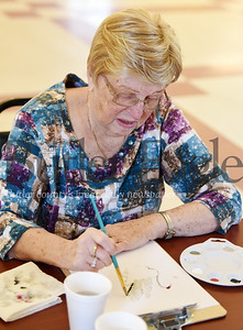 Harold Aughton/Butler Eagle: Pat Enslen of Connoquennessing Twp. participates in a painting class at the Evans City senior center.