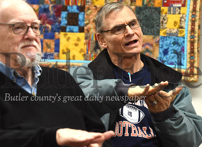 Robert Sebastian (right) and Harry Webb of Cranberry follow along with an American Sign Language greeting demonstration at the Zelienople Library Monday night. Seb Foltz/Butler 01/13/20