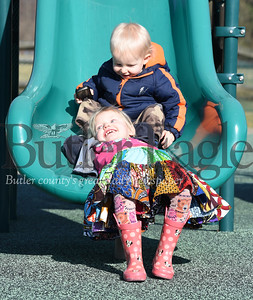 Harold Aughton/Butler Eagle:  Kelley Angleberger of Evans City stopped by the Seven Fields playground after running errands with her children Abigail, 3, and Shepherd, 1, Wednesday afternoon, January 15, 2020. Abigail Angleberger, 3, reacts to her brother, Sepherd, 1, sliding into her at the Seven Fields community park.