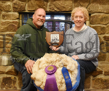 Harold Aughton/Butler Eagle: Harold and Connie Dunn of Connoquenessing Twp. and their grand champion sheep.