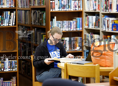 Library assistant Shari Hunt sorts through books at the Prospect Library Wednesday. Seb Foltz/Butler Eagle 01/22/20