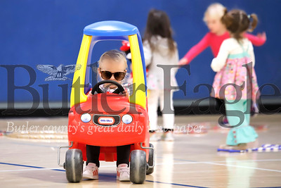 Wearing her mom's sunglasses, Madi Ori, 2, of Cranberry goes for a toy car cruise around the Cranberry Township Municipal Center Gym Thursday during the township's Playtime Pals program. The program for kids age 5 and under and their parents takes place Tuesdays and Thursdays, activities include open gym time, games, lunch and craft projects. Seb Foltz/Butler Eagle