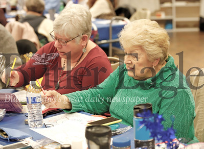 Sandy West(left) of Zelienople and Shirley DeSimone chat and color placemats prior to lunch at the Cranberry Senior Center's Winter Blues Party Thursday. Seb Foltz/Butler Eagle 01/23/20