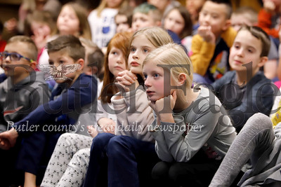 Alexa Agnew(right), Sophia Karalus and their fellow second graders at Rowan Elementary School listen intently to a presentation on bats from a guest speaker with the Audobon Society of Western Pennsylvania Tuesday. Seb Foltz Butler Eagle 01/28/20