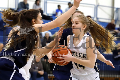 Butler's Macklin Hanley (14) attempts to get to the hoop against Norwin's Cassie Cole. Seb Foltz/Butler Eagle