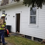 .A firefighter checks the fan used to air out an apartment on Thursday morning at 3051/2 East Penn St. The tenant called 911 when a fire broke out while he was cooking. The duplex partially in view behind this house at 305 Penn St. sustained about $10,000 in damages on Thursday morning as a result of a cooking fire.