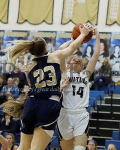 Norwin's Jacklyn Caputo (23) attempts a block on Butler's Macklin Hanley. Seb Foltz/Butler Eagle