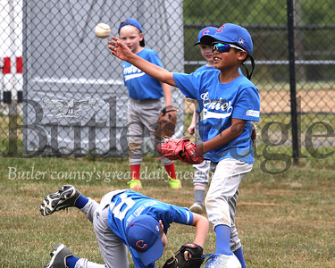 Sage Seezox throws a fly ball back to his coach during 6-8-year-old Center Township little league pregame practice last Friday. Seb Foltz/Butler Eagle 06/26/20