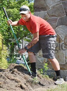 Harold Aughton/Butler Eagle: Ray Dean III prepares the mulch beds at the West Sunbury veterans memorial as part of his Eagle Scout project. Thursday, June 2, 2020.