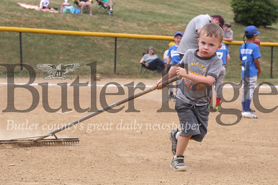 Lincoln Daubenspeck, 4, rakes the infield ahead of a 6-8-year-old little league game in Center Township last Friday. Seb Foltz/Butler Eagle 06/26/20