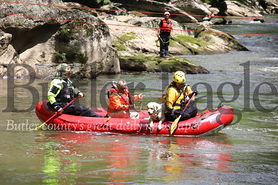 Butler County Water Rescue Team 300 members and a canine search crew from Sarver-based Canine Aided Emergency Search And Rescue float a section of Slippery Rock Creek searching for Jeff Hanby back on Sunday May 31 after dogs picked up a sent near where Hanby was last seen. Seb Foltz/Butler Eagle