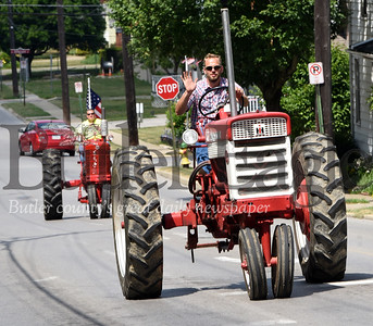 Harold Aughton/Butler Eagle: Tractors, trucks, antique cares and even a Cement Truck barreled along Grandview Ave in Zelienople on Saturday during the 4th of July porch parade.