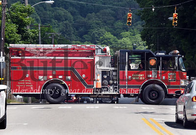 Harold Aughton/Butler Eagle: A fire truck from Harmony VOL fire department crosses over main street in Zeilenople during the July 4th Porch parade.