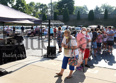 Harold Aughton/Butler Eagle: A long line of customers formed outside prior to the grand opening of Sprankle's Neighborhood Market in Saxonburg July 4, 2020.