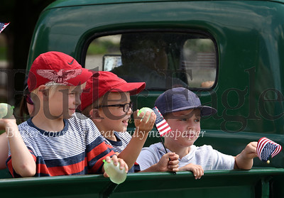 Harold Aughton/Butler Eagle: Armed with water ballons a group of young boys ride in back of an antique Ford pickup truck during the 4th of July parade in Zelienople.