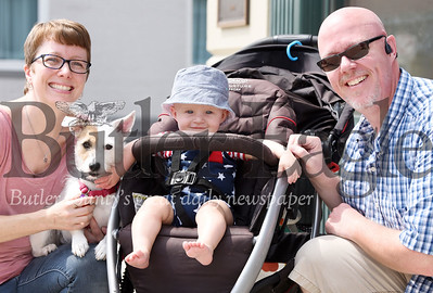 Harold Aughton/Butler Eagle: Seven-month-old Isac Bills got to see his first 4th of July parade in Zelienople with his parents Lisa and Jim Billls of Evans City.