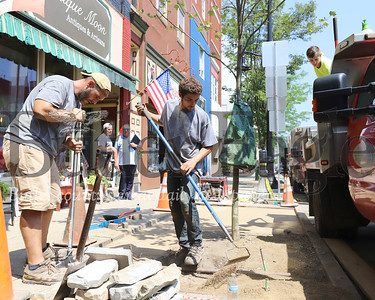 Brian Capotok and Ben Senchak of Gargiulo Lanscaping work on a tree planting and pavement project on Main St. in Butler Friday, part of a city tree planting initiative. Seb Foltz/Butler Eagle 071020