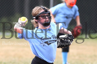 Seneca 10-and-under little league softball shortstop Denali Pitell throws to first in a game against Mars Thursday (07/09/20) (at Mars fields on 228). Seb Foltz/Butler Eagle