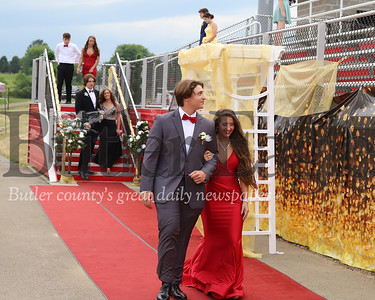 Slippery Rock High School seniors walk into Troy Alan Stadium for prom Friday 7/10/20. Students were able to announce prom king and queen before moving inside to the gym because of storms passing through the area. Seb Foltz/Butler Eagle