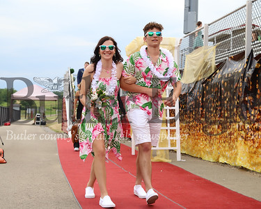 Lexis Prementine and Nate Gill strut down the red carpet at Slippery Rock High School's Troy Alan Stadium for prom Friday. Following the crowning of the prom king and queen, festivities had to be moved indoors because of storms passing through the area. 07/10/20. Seb Foltz/Butler Eagle