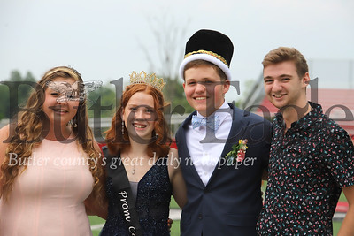 2020 Slippery Rock High School Prom queen Karen Daugherty (center left) and king Jace Franco, pose with 2019 winners Mekenzie Pflueger (left) and Marcus Howell after being crowned Friday. Seb Foltz/Butler Eagle