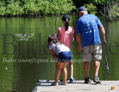 Harold Aughton/Butler Eagle: Richard Sittler took his granddaughters, Mackenzie, 10, and Madison Peck, 7, at Glade Run Lake Monday afternoon. July 13, 2020.