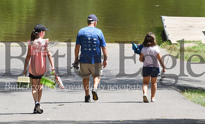 Harold Aughton/Butler Eagle: Richard Sittler to his granddaughters, Mackenzie, 10, and Madison Peck, 7, at Glade Run Lake Monday afternoon. July 13, 2020.