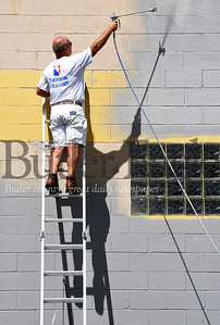 Harold Aughton/Butler Eagle: Time Swartz of Exceptional Appearances Painting paints a warehouse for Mister Feed in Saxonburg Tuesday, July 14, 2020.