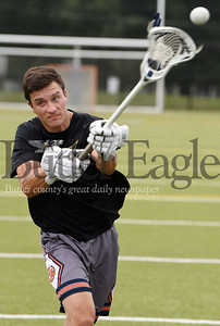 Harold Aughton/Butler Eagle: Caleb Raydo, a rising senior at Mars and a member of the lacrosse team practices his skills Monday afternoon at the high school.