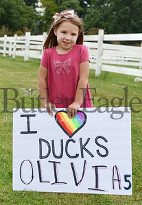 Harold Aughton/Butler Eagle: Olivia May, 5, of Zelienople stands in front of her homemade sign along route 68 Thursday, July 16, 2020.