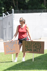 Ailvie Rausch stand with two signs during a rally at the Butler Barracks of the state police in Butler Township on Friday, July 17, 2020 afternoon. Rausch's son, Scott Fosnaught and his friend Shawn Baur died in 2002 after a mysterious accident on Cashdollar Road. No one has been charged in their deaths. Those who attended the rally, which was organized by We Can Bring You Hope, do so to bring awareness to the 18-yearold cold case involving her son and in hopes of finding convincing people to submit tips about the accident.Photo by Lauryn Halahurich