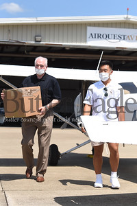U.S Rep. Mike Kelly, left, and Thomas Kim Jr. of Virginia unloaded boxes of personal protective equipment that Kim delivered to the Butler Memorial Hospital via flight.