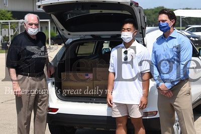 From left to right, U.S. Rep. Mike Kelly, Thomas Kim Jr. of Viriginia and Butler Memorila Hospital's Chief Medical Officer Dave Rottinghaus stand before Kim's delivery of protective personal equipment to the hospital Saturday.