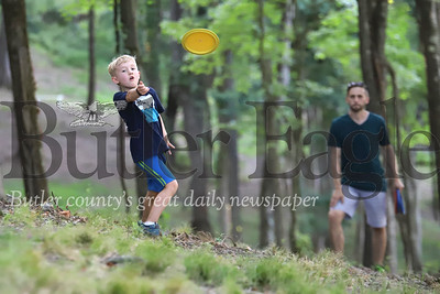 Abe Wharton,6, throws a disc golf disc at North Boundary Park in Cranberry Thursday with his dad, Tim Wharton and his brother Eli, 8, and mom Erin (not pictured). Seb Foltz/Butler Eagle 07/15/20