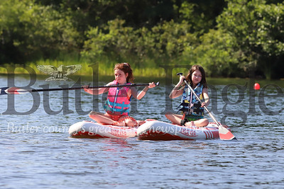 Allison Takac, 11, (left) and Brooke Dugan,11, of Cranberry paddle near the McDanels Boat Launch at Morraine State Park Wednesday. Seb Foltz/Butler Eagle 071520