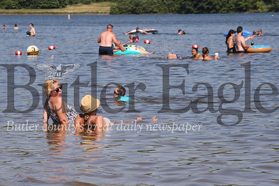 Beach goers relax in Lake Arthur on Moraine State Parks South Shore. Seb Foltz/Butler Eagle 7/18/20