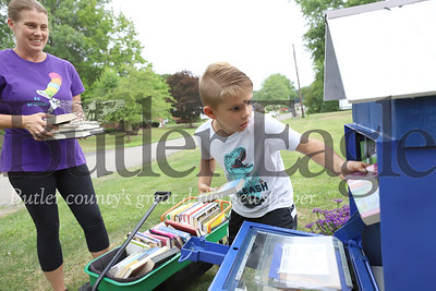 Parker Knobeloch and his mom Marlene load up their new library box with donated books at their Penn Township home. Seb Foltz/Butler Eagle