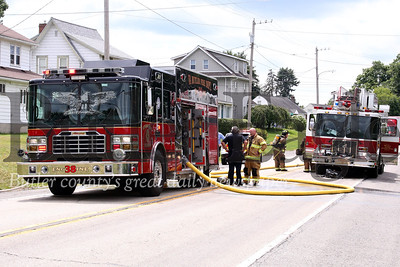 Firefighters respond to a house fire on Evans City Road Wednesday. Seb Foltz/Butler Eagle 07/22/20