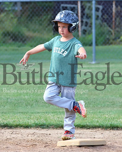 Bently Mottern finds his center with a little second base yoga during the final game of Butler little league's 7U season Wednesday. Seb Foltz/Butler Eagle 07/22/20