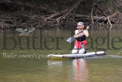Carol Giannandrea paddles Connequenessing Creek, near Harmony Thursday (July 2). Seb Foltz/Butler Eagle