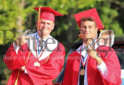 Jake Tomer(left) and Jackson Pachall celebrate during Graduation ceremonies at North Catholic Friday. Seb Foltz/Butler Eagle 07/24/20