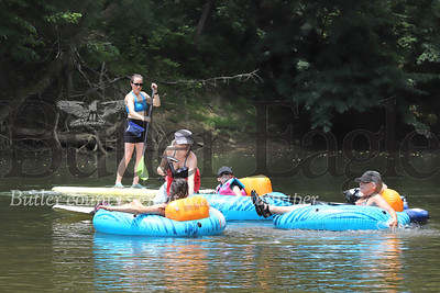 Cara Giannandrea (left) and her mother Carol Giannandrea paddleboard the Connoquenessing with friends Thursday (July 2) near the Harmony Canoe & Kayak Launch. Seb Foltz/Butler Eagle