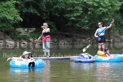 Cara Giannandrea (right) and her mother Carol Giannandrea paddleboard the Connoquenessing with friends Thursday (July 2) near the Harmony Canoe & Kayak Launch. Seb Foltz/Butler Eagle