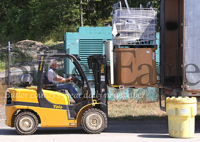 Brad McVeigh with Cranberry Township Public Works loads a stack of televisions and assorted electronics into a truck with a forklift. Seb Foltz/Butler Eagle