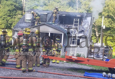 Jim Smith photoFirefighters battle a blaze Sunday morning at a home on the 900 block of Clearfield Road in Clearfield Township. No one was home when the fire was reported about 7:40 a.m. The home was destroyed, authorities said. The state police fire marshal has been notified, but a cause was not immediately known.